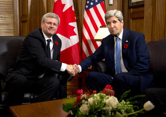 Canada's PM Harper and U.S. Secretary of State Kerry shake hands as they meet on Parliament Hill in Ottawa