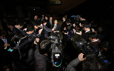Japan's Chief Cabinet Secretary Suga speaks to the media at PM Abe's official residence in Tokyo
