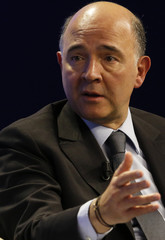 French Economy and Finance Minister Moscovici attends a session at the annual meeting of the World Economic Forum (WEF) in Davos