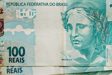 Macro close-up of 100 reais Brazilian bills viewed from above