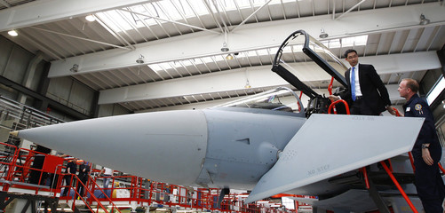 German Minister for Economics and Chairman of Germany's FDP Roesler stands next to a Eurofighter Typhoon during his visit to the headquarters of Cassidian's Military Air Systems Centre in Manching
