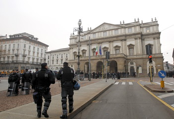 Police patrol in front of Milan's La Scala opera house before the opening of the 2015-16 opera season