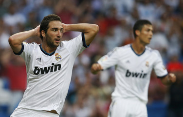 Real Madrid's Higuain and Ronaldo react during their Spanish first division soccer match against Valencia in Madrid