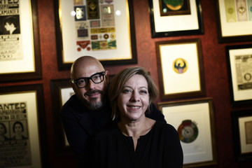 Graphic designers Miraphora Mina and Eduardo Lima pose during an interview with Reuters at the 'House of MinaLima' in London