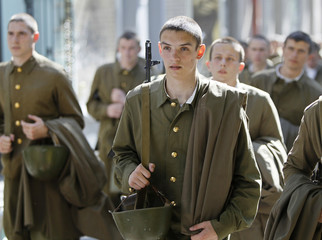 Military school students dressed in Red Army uniforms walk during a historic re-enactment in Kiev