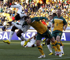 Australia's Brett Emerton fights for the balll with Ghana's Prince Tagoe during a 2010 World Cup Group D soccer match in Rustenburg