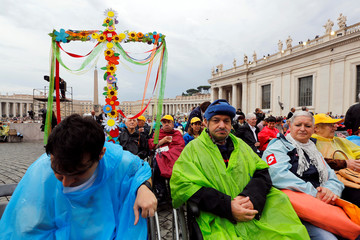The faithful attend a mass celebrated by Pope Francis during a Jubilee for the sick and disabled in Saint Peter's Square at the Vatican