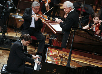 Miroslav Kultyshev of Russia performs with orchestra conducted by Wit during the finals of the 16th International Fryderyk Chopin Piano Competition in Warsaw.