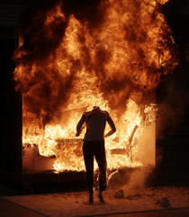 Controlled burn demonstration in a constructed room blazes away during a media open house at the Alcohol Tobacco and Firearms (ATF) National Laboratory Center in Beltsville Maryland