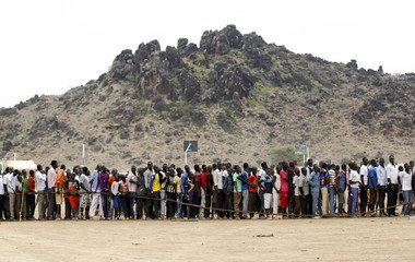 Refugees from South Sudan queue to attend the celebrations to mark World Refugee Day at Kakuma refugee camp in Turkana District, northwest of Kenya's capital Nairobi