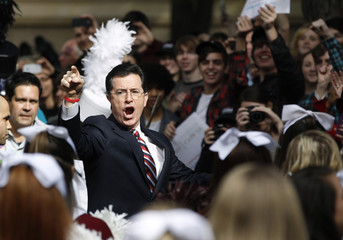 Stephen Colbert hosts a South Carolina primary rally with Herman Cain at the College of Charleston