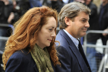 Former News International chief executive Rebekah Brooks and her husband Charlie Brooks arrive at Westminster Magistrates' Court in London