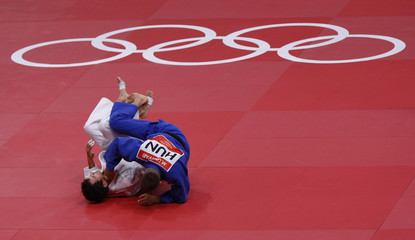 Spain's Sugoi Uriarte fights with Hungary's Miklos Ungvari during their men's -66kg semi-final A judo match at London 2012 Olympic Games