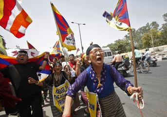 Tibetan exiles shout slogans during a protest against Chinese Premier Li Keqiang's visit to India, at Majnu Ka Tila, a Tibetan refugee camp, in New Delhi