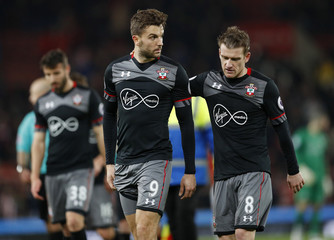 Southampton's Jay Rodriguez and Steven Davis look dejected at the end of the match