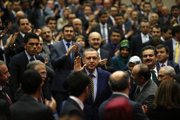 Turkey's Prime Minister Tayyip Erdogan greets members of his ruling AK Party in Ankara