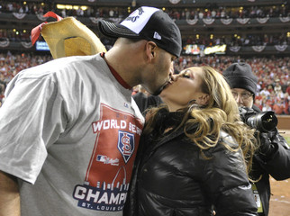 St. Louis Cardinals first baseman Pujols kisses his wife Deidre after the Cardinals defeated the Texas Rangers to win MLB's World Series baseball championship in St. Louis