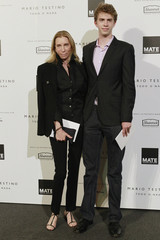 Goodman, an editor at Vogue, and her son Cole, pose for photographers at the opening of MATE, Mario Testino cultural organisation, in Lima