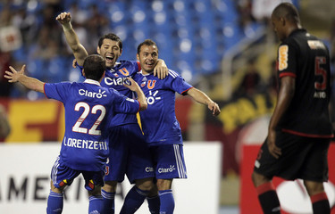 Chile's Universidad de Chile's Jose Rojas celebrates with teammates after scoring against Brazil's Flamengo during a Copa Sudamericana soccer match in Rio de Janeiro