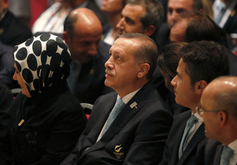 Turkish Prime Minister Tayyip Erdogan sits with members of the Istanbul bid committee after Jacques Rogge President of the International Olympic Committee announced Tokyo as the city to host the 2020 Summer Olympic Game during a ceremony in Buenos Aires