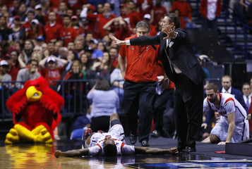 Louisville coach Pitino calls to the referees to stop the game as guard Kevin Ware lays on the court against Duke during their Midwest Regional NCAA men's basketball game in Indianapolis