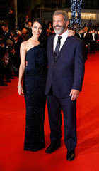 """Cast member Mel Gibson and partner Rosalind Ross pose on the red carpet ahead of the screening of the film """"Blood Father"""" out of competition at the 69th Cannes Film Festival in Cannes"""