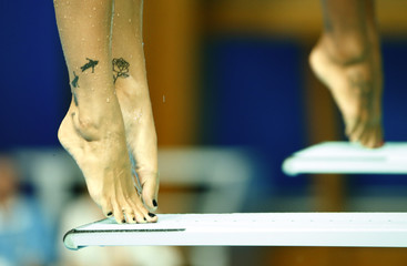 Tatoos are pictured on the legs of Canada's Ware during the women's synchronized 3m springboard final at the Aquatics World Championships in Kazan