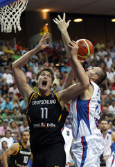 Macvan of Serbia goes up for the basket past Pleiss of Germany during their FIBA Basketball World Championship game in Kayseri