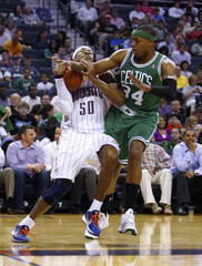 Charlotte Bobcats Maggette is fouled by Boston Celtics Pierce during their NBA basketball game in Charlotte