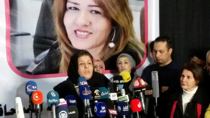 Iraqi journalist Afrah al-Qaisi, who was released unharmed after being kidnapped by unidentified gunmen a week ago, speaks to the media in Baghdad, Iraq