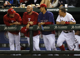 Rangers Holland, Harrison, Darvish and Murphy talk during their game against the Los Angeles Angels in Arlington, Texas
