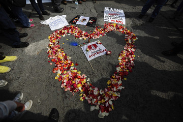 Flowers arranged in the shape of a heart are seen during a protest to demand more information about the missing students of the Ayotzinapa Teachers' Training College 'Raul Isidro Burgos' at Zocalo Square in Mexico City