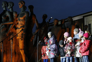 People attend a rally to commemorate victims of the military conflict in eastern regions of Ukraine in Moscow