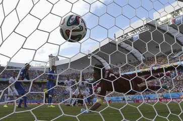 Italy's goalkeeper Buffon concedes a goal to Uruguay's Godin during their 2014 World Cup Group D soccer match at the Dunas arena in Natal