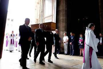 Pallbearers carry the coffin of slain French parish priest Father Jacques Hamel as they enter the Cathedral in Rouen