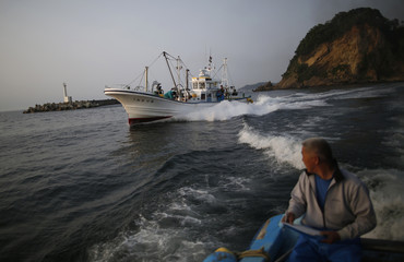 Fishermen sail, as they take part in a census of fish close to the Fukushima Daiichi nuclear power plant, in Hisanohama port in Iwaki, Fukushima prefecture