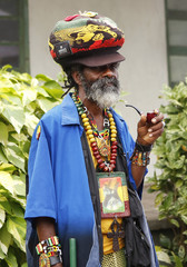 Member of the Rastafarian movement waits for the unveiling of a statue of late reggae legend Bob Marley in Kingston