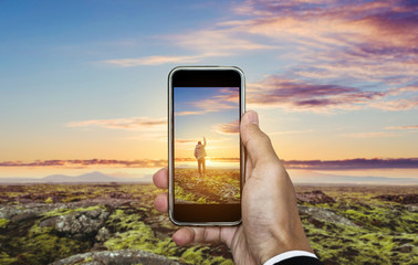 Travel photography by smartphone, traveling and taking photo concept