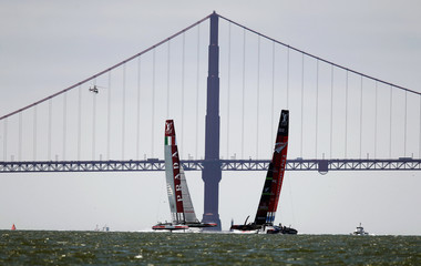 Italy's Luna Rossa Challenge and Emirates Team New Zealand sail near the Golden Gate Bridge during the fourth race of the Louis Vuitton Cup challenger series sailing finals in San Francisco
