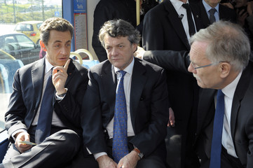 France's President and UMP party candidate for the 2012 French presidential elections Sarkozy and France's former Ecology Minister Borloo ride a tramway during a campaign visit in Valenciennes