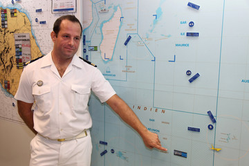 Arnaud Le Mentec, French naval officer and deputy director of the CROSS Reunion, shows a map during a news conference at the CROSS