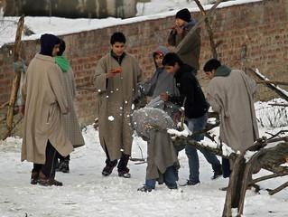 Boys throw snowballs at each other after a snowfall in Srinagar