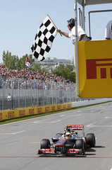 McLaren Formula One driver Hamilton takes the chequered flag to win the Canadian F1 Grand Prix at the Circuit Gilles Villeneuve in Montreal
