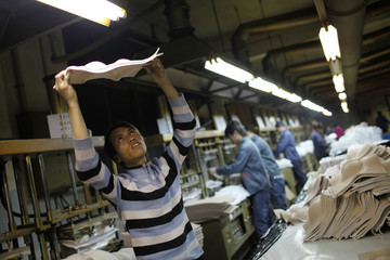 A new employee works by a production line at an underwear factory in Shanghai