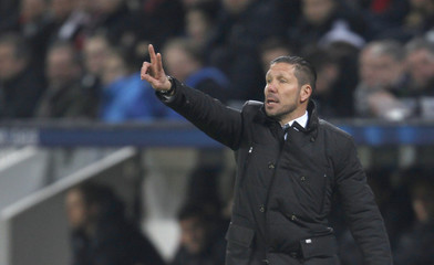 Atletico Madrid's coach Simeone gestures during Champions League soccer match against Bayer Leverkusen in Leverkusen