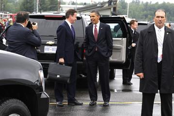 U.S. President Barack Obama and Britain's Prime Minister David Cameron chat near Huntsville