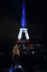 "Celine Dion performs""Hymne ? l'amour"" in honor of the victims of the recent Paris attacks as an image of the Eiffel Tower is shown in the background during the 2015 American Music Awards in Los Angeles"
