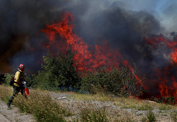 A firefighter battles the Ranch Fire near San Diego