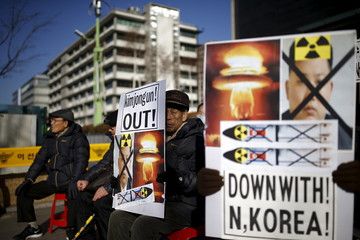 Protester hold banners depicting North Korean leader Kim Jong Un during an anti-North Korea rally in central Seoul