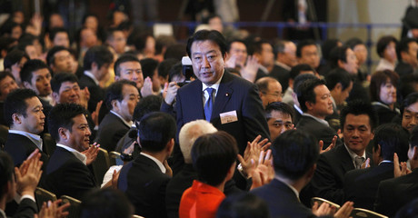 Japan's Finance Minister Yoshihiko Noda stands up as he is chosen as the Democratic Party of Japan's new leader in Tokyo